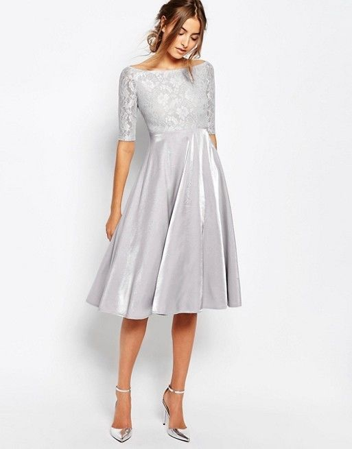 Silver Lace Bridesmaid Dress: Bridesmaid dresses with sleeves are always an elegant fall choice. This tea-length dress with a metallic skirt and lace boatneck bodice, is a vintage find with modern flair. This tone contrasts well with dark fall colors.