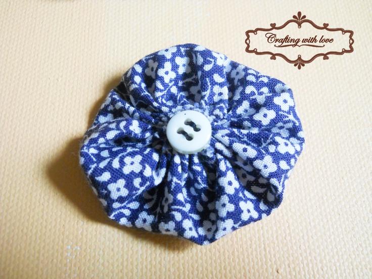 Fabric handmade brooch.
