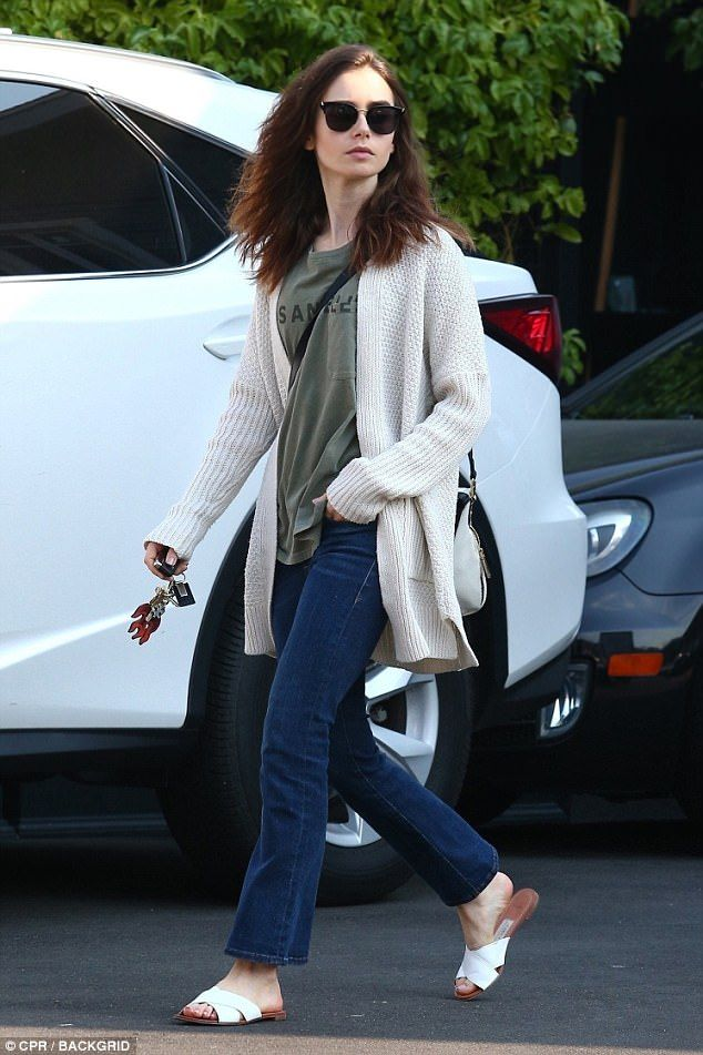 Lily Collins swaps red carpet glamour for tousled waves   Daily Mail Online