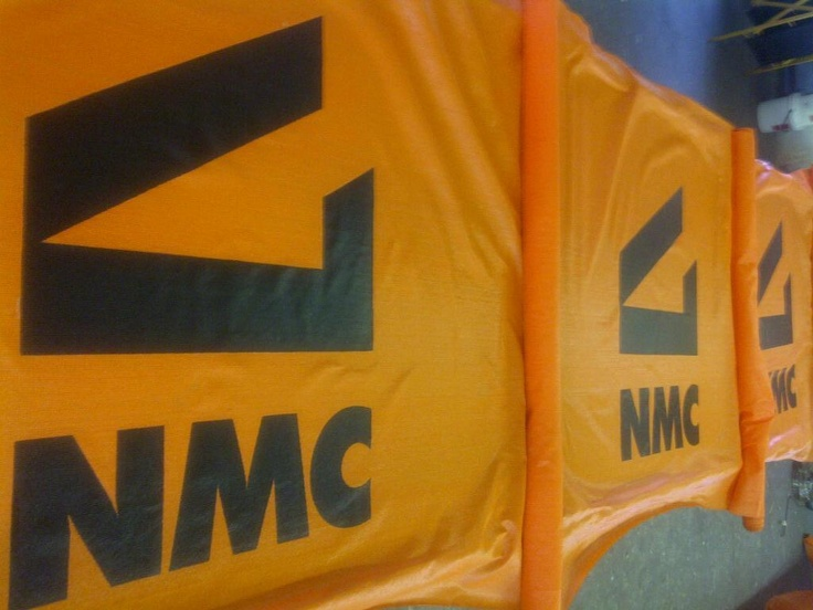 Picture of NMC printed on printed shade cloth .