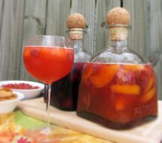 raspberry peach and strawberry lime sangria recipes! perfect for the warm weather...love the idea using patron bottles for the drinks....