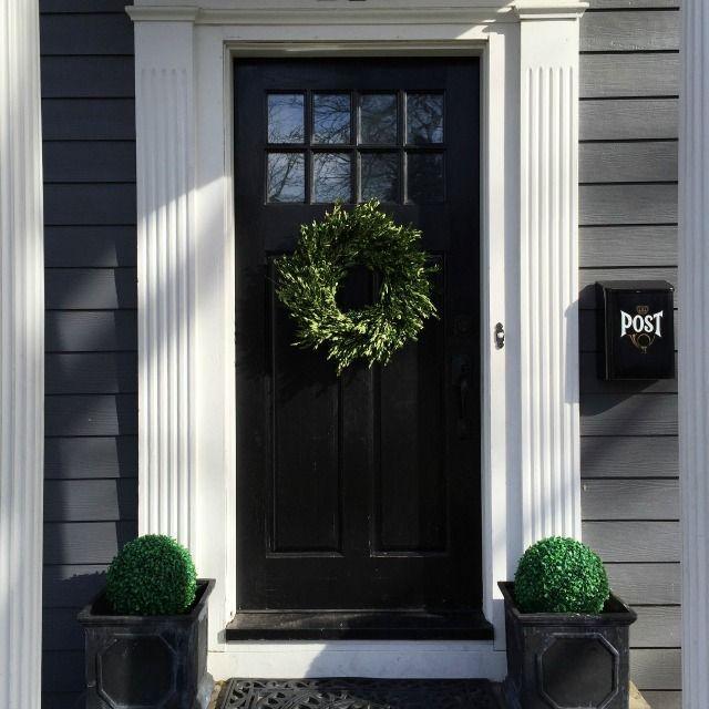 Dramatic black front door http://eclecticallyvintage.com - rebuild front door/entry.