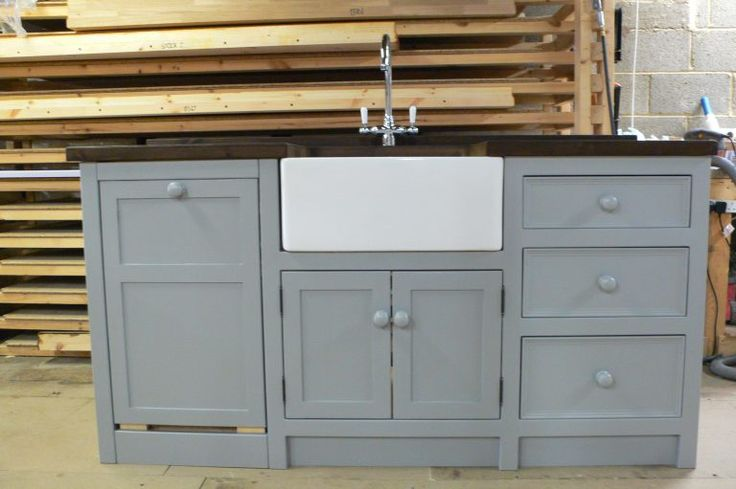 This Belfast sink unit is built for an integrated slimline dishwasher,it is painted in 'manor house grey' and is topped with a 40mm ebonised worktop