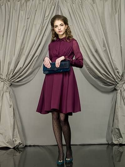 Larusmiani Women Collection FW2013 - Look of the week - This is Larusmiani #woman, wearing a silk burgundy hand-smocked evening #dress with jewelbuttons. Timeless charme with a touch of# style: the blue ponyskin clutch in her hands.  www.larusmiani.it  #larusmiani #handmade #luxuryclothing