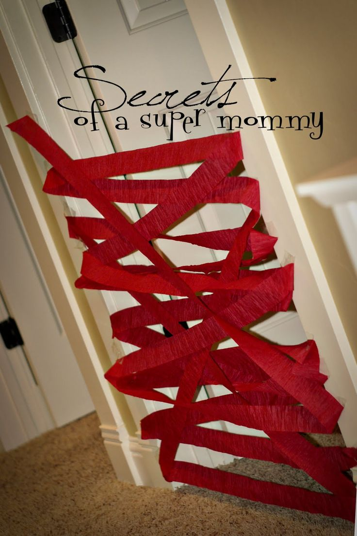 Crepe paper the door for Christmas so they have to bust out when they wake up. Tell them Santa did this to make sure they stayed in their rooms.  We started this tradition last year after I saw it on Secrets of a Super Mommy, and my girls loved it! - See more at: http://www.growingajeweledrose.com/2013/12/make-christmas-magical-for-kids.html?m=1#sthash.jukJvA49.dpuf