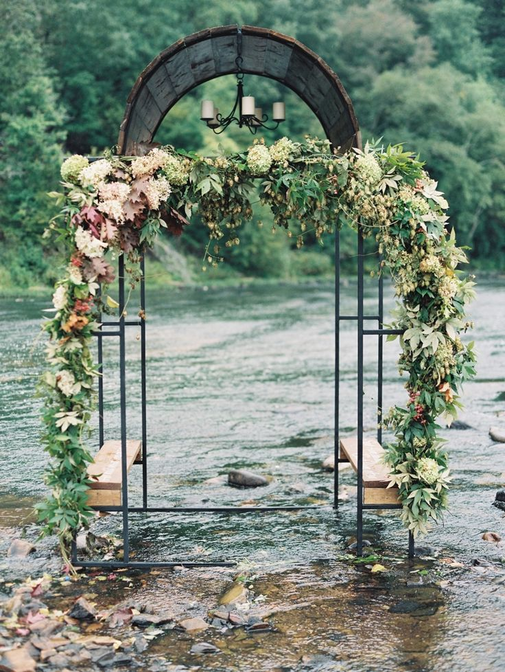 Ceremony Venue: Flint River- Thomaston, Georgia -  Event Design: The Bride -  Floral Design: Lindsay Coletta - http://www.stylemepretty.com/portfolio/lindsay-colletta   Read More on SMP: http://www.stylemepretty.com/2016/03/31/march-madness-this-is-what-happens-when-you-literally-get-married-in-a-river/