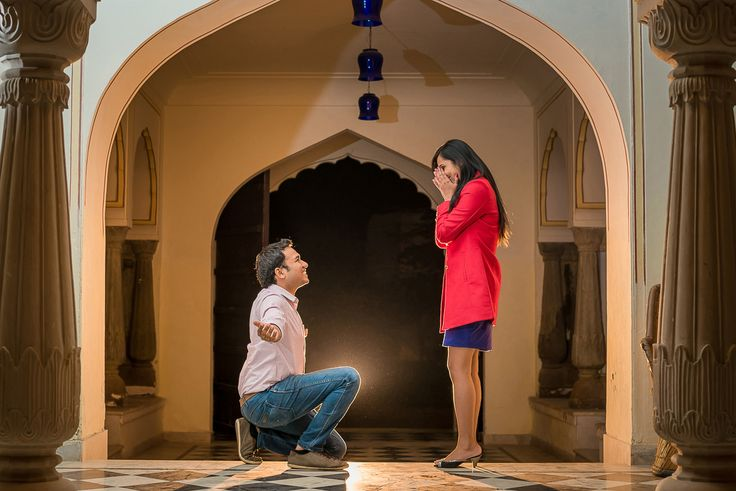 Jaipur-Pre-wedding-shoot A casual #Denim #Jeans with a solid coloured #pink shirt for the Boy and Girl in a solid #purple colored short dress makes it a perfect choice for a romantic evening couple shoot.  A red Jacket on top of it will work like a charm.