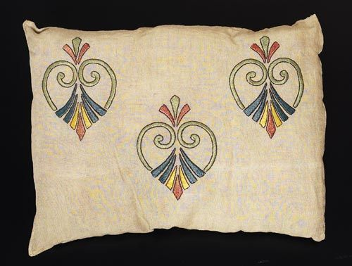 "263. Arts & Crafts pillow, Unknown maker and number, ca. 1908-1913, green, red, yellow, blue and black floss on oatmeal linen fabric, satin and outline stitches, conventional motif, 20"" x 15"", a couple of thin spots; otherwise excellent condition 250-350"