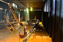 The Hjortspring boat is similar to a large canoe in design, from the Scandinavian Iron Age (circa 350BC). Excavated in 1921–1922 in Hjortspring Mose at Als in Sønderjylland. It was a clinker-built wooden boat 21 m long (length overall), 13 m long inside and 2 m wide with space for a crew of 2 dozen men who propelled the boat with maple root paddles; making it swift in the water. Built 1,000 years before the Viking raids, these were the forefathers from whose seeds the latter-day Vikings…