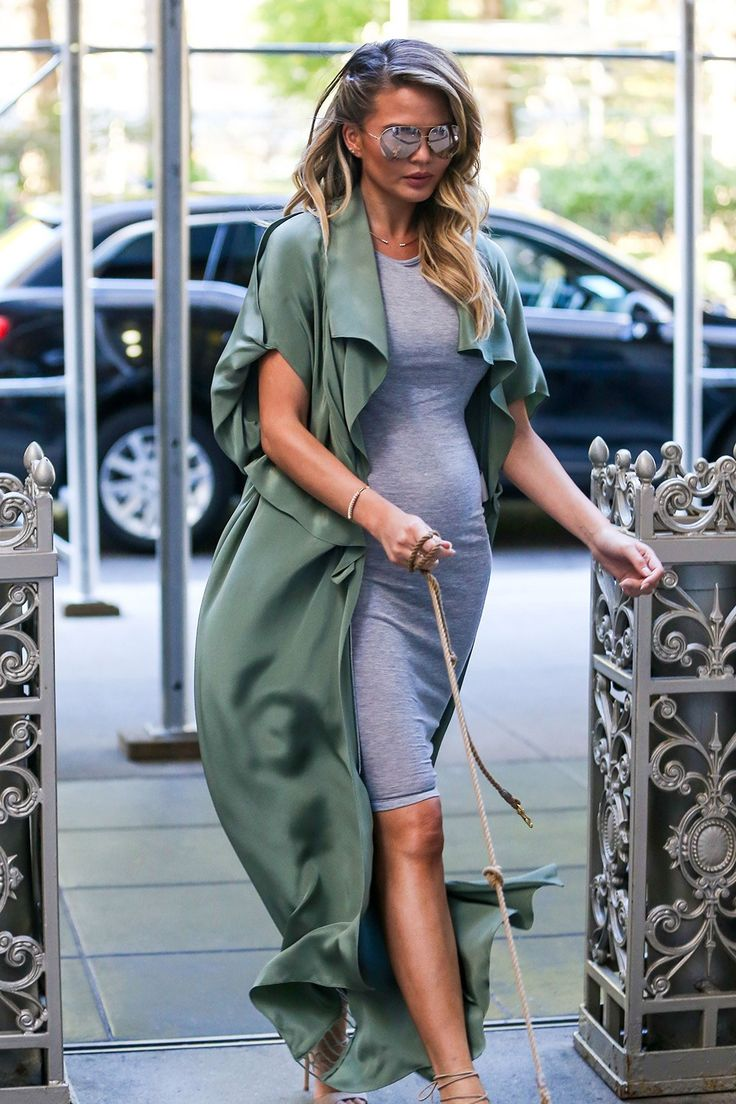 Chrissy Teigen wears grey body-con midi dress with green silk long cardigan with nude scrappy heels and reflective aviator sunglasses