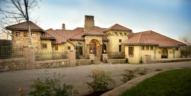 GORGEOUS! With a big entry way and a gate this house would be spectacular