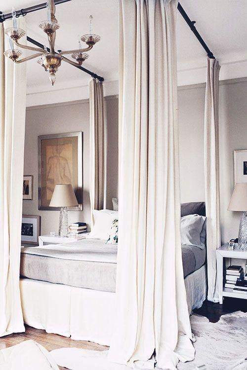 Modern Canopy Bed Complete With White Floor To Ceiling Drapes A Neutral Dove