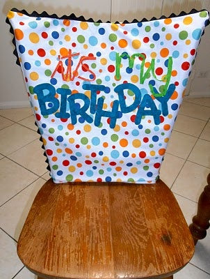 "'It's my birthday' chair cover - cute idea to go with the ""you're special"" plate"