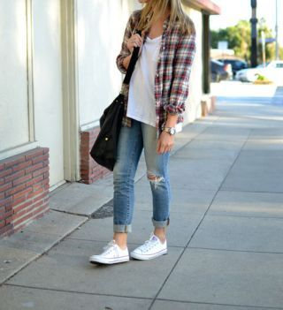 A plaid flannel shirt, ripped jeans and white chucks