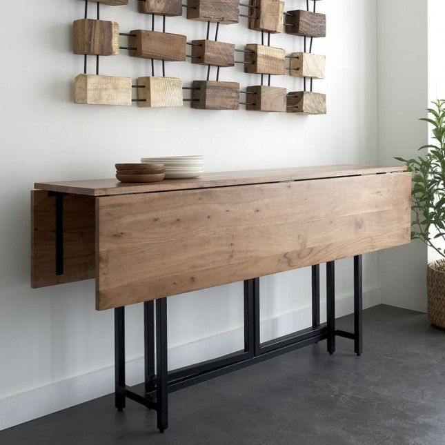 Something like this, drop leaf on one side but the other side to fold on top so bar stools can be used like behind couch but when needed full table, can pull out and open up