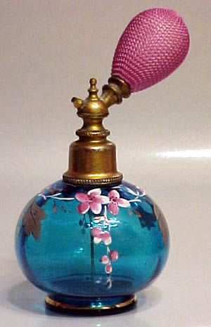 Victorian 1890s footed ball shape perfume atomizer in a rich transparent teal blue colour, gilt accents and enamelled with flowers and foliage.