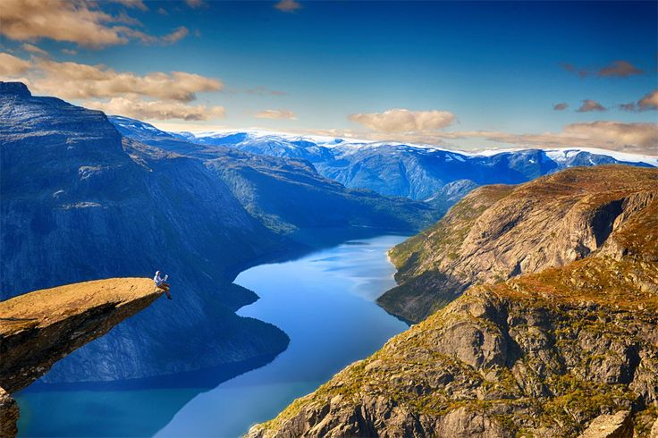 Trolltunga is a piece of rock jutting horizontally out of a mountain about 700 metres above the north side of the lake Ringedalsvatnet in the municipality of Odda in Hordaland county, Norway.