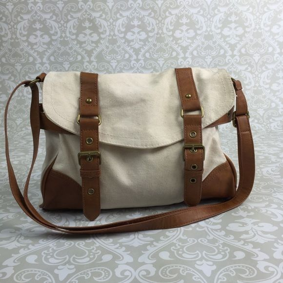 Aéropostale canvas crossbody purse bag w/ buckles Super cute. Just some discoloration on the back Aeropostale Bags Crossbody Bags