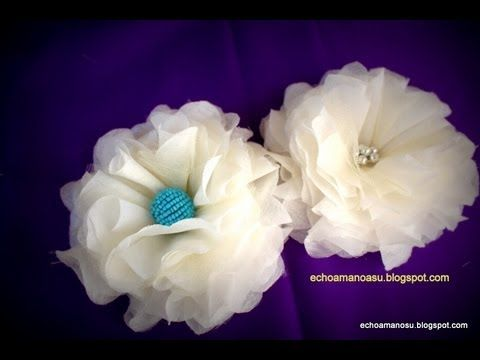 fabric flower very easy method - YouTube.  This is a good tutorial with excellent technique for getting layers out to the edge of the flower without too much bulk and the occasional piece of tulle is a great idea.