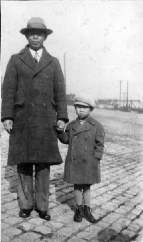 Richard Hahn and man standing on bricks. http://digitallibrary.usc.edu/cdm/ref/collection/p15799coll126/id/13532