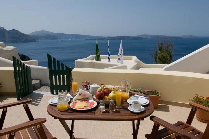 Enjoy your breakfast! #View_from_Caldera. Private Villas by Anemomilos.