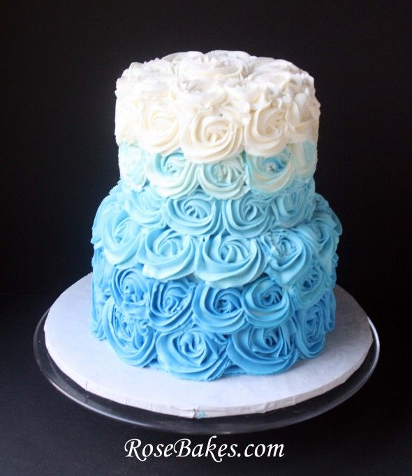 A Blue Ombre Buttercream Roses Wedding Cake for a Beach-Themed Wedding.  Plus a small heart-shaped cake for the bride and groom to share!