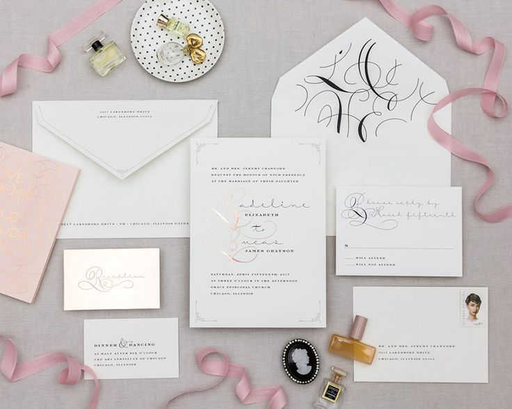 Rose Water: Lovely lettering is fluid throughout the suite. The couple's names are accentuated by a metallic foil drop cap that becomes a monogram. The L-O-V-E envelope liner is an unexpected detail. Cheree Berry Paper