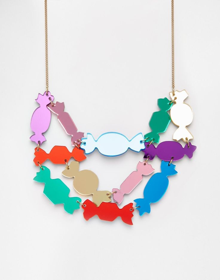 Tatty Devine Sweet Wrapper Necklace | I'm finding this inspirational because of how the colour is coming through the perspex. Cut shapes out of clear shrink plastic, shrink it and spray paint just one side. The spray painted side is the back, and the clear plastic is the front, creating a cool magnifying effect. Awesome!