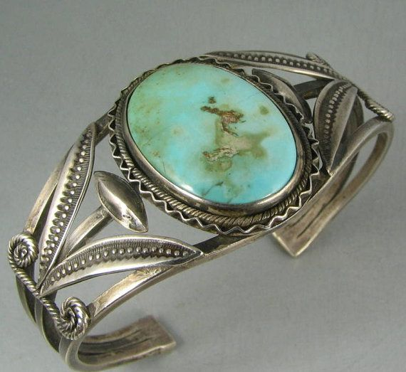 AAAH! i've never wanted a piece of jewelry so badly!  But with a darker colored stone though
