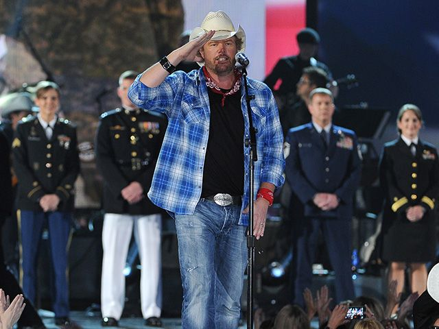 The country artist won't back away from the opportunity to perform for the country and its military, he said in a statement.