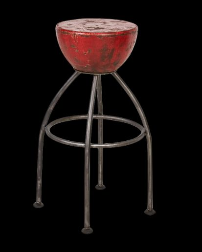 An industrial style barstool made from steel with a solid salvaged elm seat.