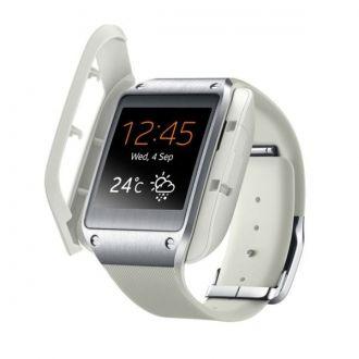 Stacja do ładowania baterii w zegarku multimedialnym Samsung Galaxy Gear.  Produkt w kolorze beżowym.