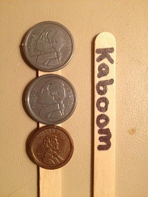 """money game - Hot glue some coins to about 20 popsicle sticks. Write """"Kaboom"""" on about 5 sticks. Kids play in groups of 2-4. When it's your turn, you pull out a stick. You add the coin values and tell the amount. If your partner or group members agree with you, you get to keep the stick. If you pull a Kaboom stick you have to put all of your sticks back in the cup."""