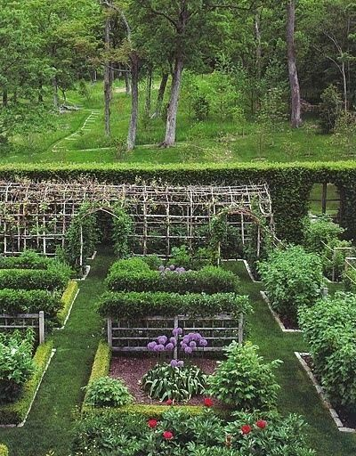 Love the arbor and the path leading out into the woods behind the garden