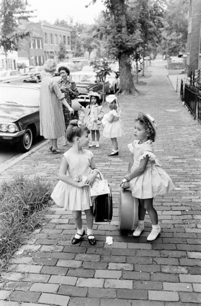 someone please help these little white children with their luggage. where is a servant when you need one?