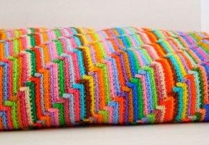 Get your groove on with this psychedelic rainbow crochet blanket. The Vintage Crochet Groovy-ghan is one of the most unique free vintage crochet patterns out there. | AllFreeCrochetAfghanPatterns.com