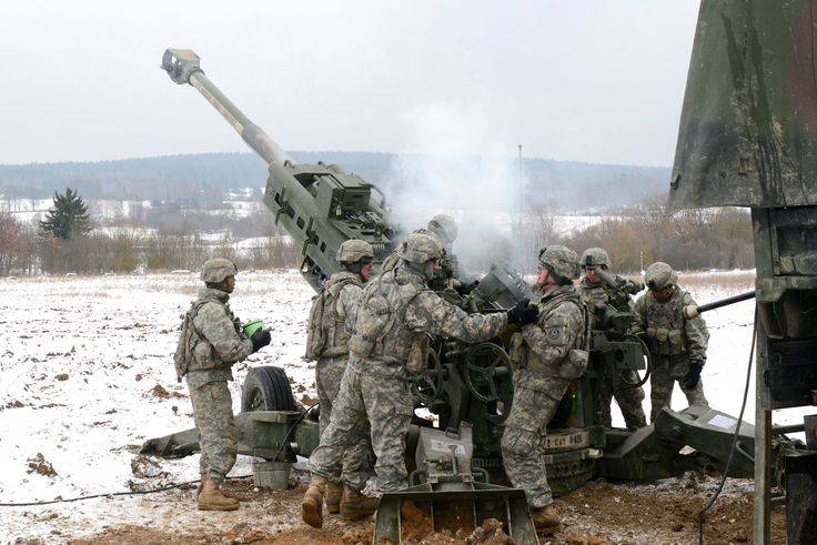 https://flic.kr/p/dUC4iS | Howitzer load | U.S. Army Soldiers assigned to Bulldog Battery,Field Artillery Squadron, 2nd Cavalry Regiment (2CR) load a M777A2 howitzer during 2CR's Maneuver Rehearsal Exercise (MRE) at Grafenwoehr Training Area, Germany on February 13, 2013. (Photo by Visual Information Specialist Gertrud Zach/released)
