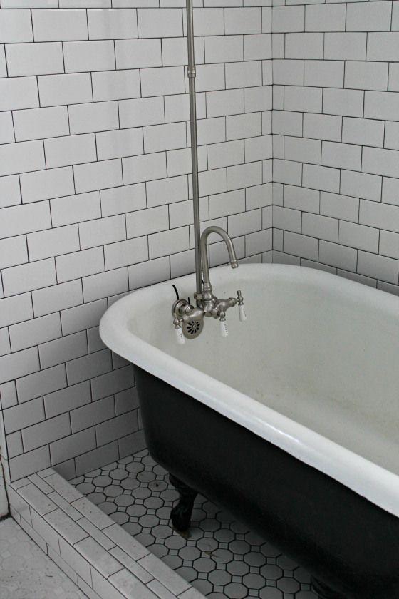 Clawfoot tub inside a ceramic shower. Love the idea!
