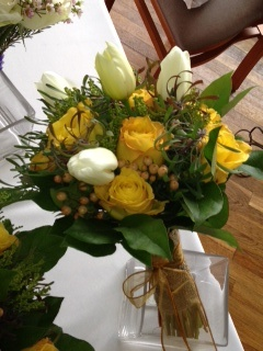 rustic bridal bouquet of yellow roses, cream French tulips, peach hypericum berries, leucadendron and lemon leaf - handle finished with burlap and burnt gold ribbon