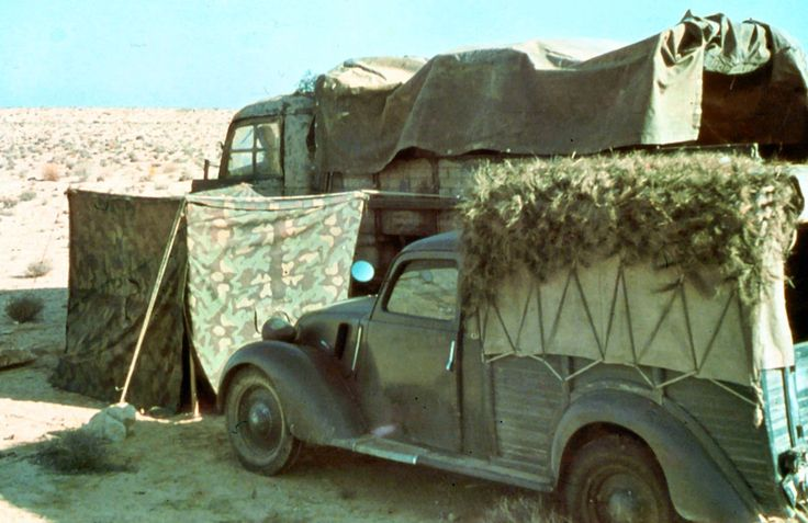 Italian vehicles in the African desert. At the front is Fiat Balilla 1100 Furgoncino, while in the background is FIAT type 666. Photo taken by General Erwin Rommel during his Campaign in North Africa, 1941