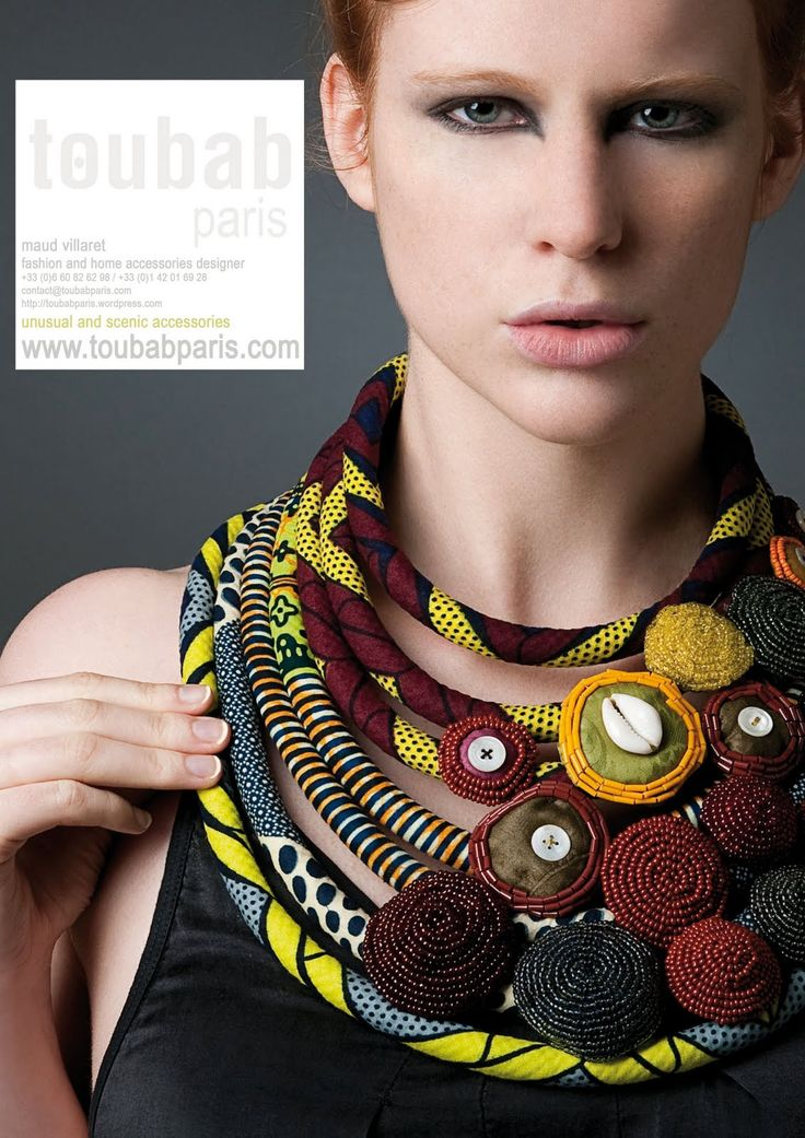 Necklace | ToubabParis Designs. Designer Maud Vilaret uses African fabrics to create her designs. These fabrics are combined often combined with glass seedbeads, shells and buttons, elements commonly found in traditional jewellery stemming from the African continent. Great idea for scrap fabric.