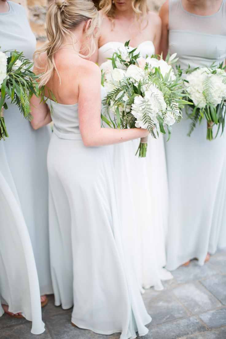Bridesmaids in Powder Blue House of Fraser Dresses with White & Greenery Bouquets | Intimate Outdoor Destination Wedding at Kinsterna Hotel & Spa in Greece | Cecelina Photography