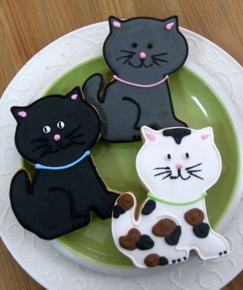 kitty cookies and like OMG! get some yourself some pawtastic adorable cat shirts, cat socks, and other cat apparel by tapping the pin!