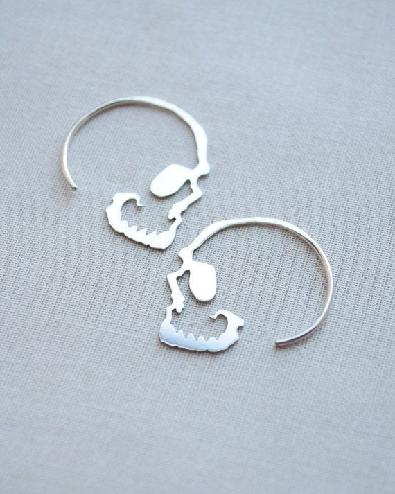 Silver Skull Hoop Earrings by Olive Yew. Unique and edgy, our simple skull hoop earrings are the perfect accessory. These are cut and handmade with love from sterling silver and measure 1 inch by 1 inch.
