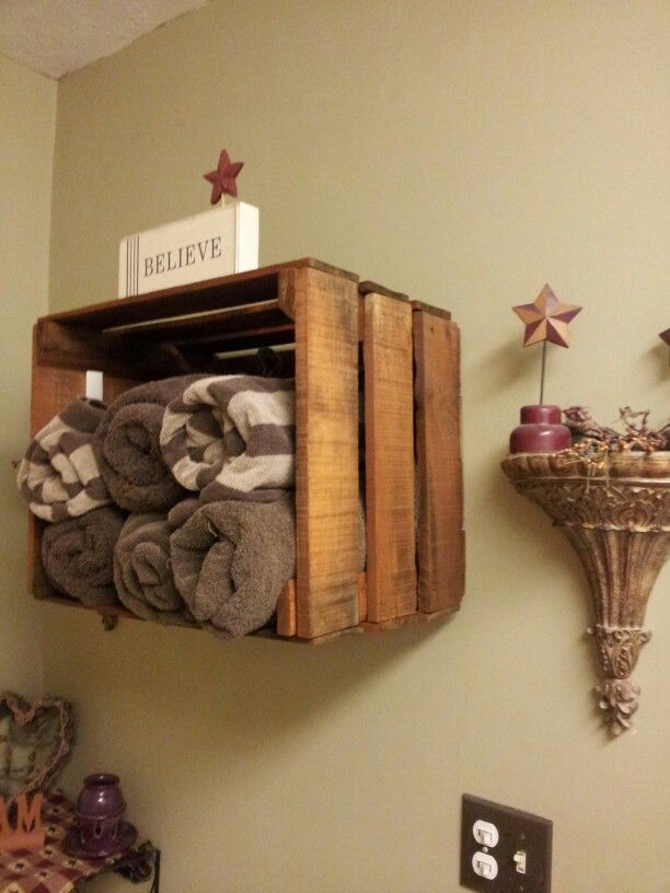 Got this idea from a pin. Put my own touch on it. Had an old crate. Then I stained it and hung it on the wall. Now it makes the perfect primitive towel rack :)
