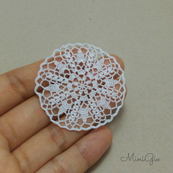 One miniature crochet doily handmade with viscose embroidery thread and a tiny hook, in white. It has a diameter of 4.5 cm (1 3/4) see more doilies in www.etsy.com/shop/MiniGio?section_id=15503178&ref=shopsection_leftnav_3 This listing include only one doily.
