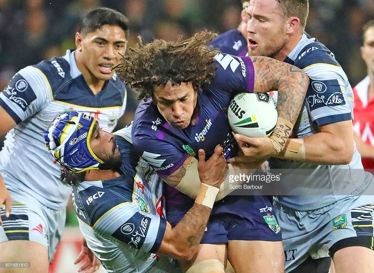 Kevin Proctor of the Storm is tackled during the NRL Qualifying Final match between the Melbourne Storm and the North Queensland Cowboys at AAMI Park on September 10, 2016 in Melbourne, Australia. #nrlfinals