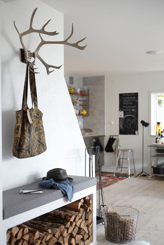 firewood + antler hooks in the entry