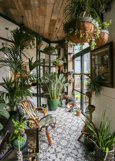 British chef and restaurateur Mark Hix's suave Bermondsey flat in southeast London is filled with plants, antiques, reclaimed items, junkyard finds, and artwork—a collector's paradise, one might say.