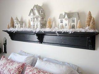 glitter houses displayed on a shelf